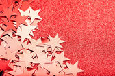Festive stars on red background — Stock Photo