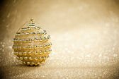 Christmas ball on sparkles background — Stok fotoğraf