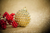 Christmas ball with european holly — Stock Photo
