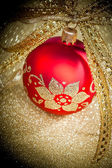 Christmas ball with golden ribbon — Стоковое фото