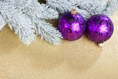 Branch of Christmas tree with snow and ball — Stock Photo