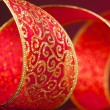 Red and golden bow on background - Stockfoto