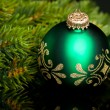 Branch of Christmas tree with festive ball - Stockfoto