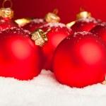 Christmas decoration balls with snow — Stock Photo