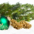 Green ball with golden pinecone — Stockfoto