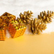 Foto Stock: Christmas decoration gift boxes with pinecone and snow
