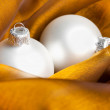 Christmas decoration on golden silk - Foto Stock