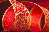 Red and golden bow on background — Stock Photo