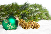 Green ball with golden pinecone — Stock Photo