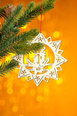 Branch of Christmas tree with decoration star — Стоковое фото
