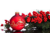Christmas decoration ball with european holly — Stock Photo