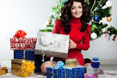 Beautiful fashionable woman with gift boxes — Stock Photo