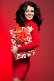 Beautiful fashionable woman with gift box — Stock Photo