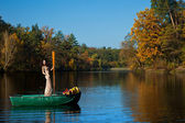 Woman on a boat in the autumn — Stock Photo