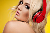 Woman in lingerie with headphones — Stock Photo