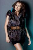 Beautiful woman in grey fur — Stock Photo