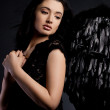 Angel with wings in black background — Stock Photo #28608695