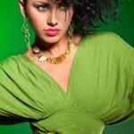 Elegant fashionable woman on green — Stock Photo #28609273