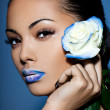 Beautiful woman with blue rose — Stock Photo