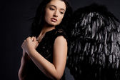 Angel with wings in black background — Stock Photo