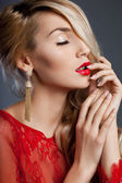 Beautiful fashionable woman with ear-rings — Stock Photo