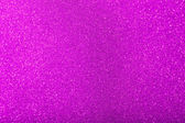 Glitter sparkles dust on background, shallow DOF — Stock Photo