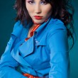 Sexy fashionable woman in blue jacket — Stock Photo #3578712