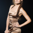 Elegant fashionable woman in golden dress — Stock Photo #3945307
