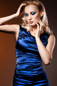 Elegant fashionable woman in blue dress — Stock Photo