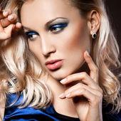 Elegant fashionable woman in blue dress — Stock Photo