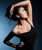 Elegant fashionable woman in black clothes — Stock Photo