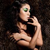 Elegant fashionable woman with green visage — Stock Photo
