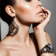 Elegant fashionable woman with silver jewelry — Stock Photo #7112688