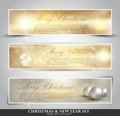 Set of three seasonal bokeh banners with snowflakes in gold back — Stockvector
