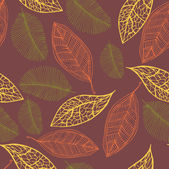 Seamless pattern with colored autumn leaves — Stock Vector