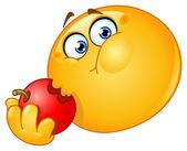 Emoticon comendo maçã — Vetorial Stock
