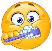 Emoticon brushing teeth — Stock Vector
