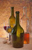 Wine in different bottles — Stock Photo