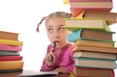 Little girl and books — Stock Photo