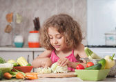 Girl preparing healthy food — Stock Photo