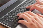 Male hands with laptop — Stock Photo