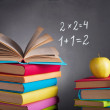 Books on the background of the school board — Stock Photo