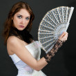 Girl with fan in white dress — Photo #4622358