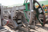Warehouse old oil pump jacks — Stock Photo