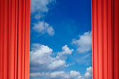 Curtains with view of clouds and sky — Stock Photo