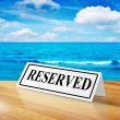 Reservation sign with beach — Stock Photo