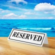 Stock Photo: Reservation sign with beach