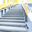 Perspective staircase inside yellow corridor — Stock Photo