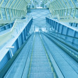 Stock Photo: Abstract steps of green escalator with persons on top