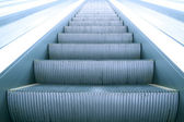 Modern steps of moving business escalator — Stock Photo